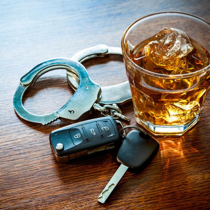 Keys, handcuff, whiskey