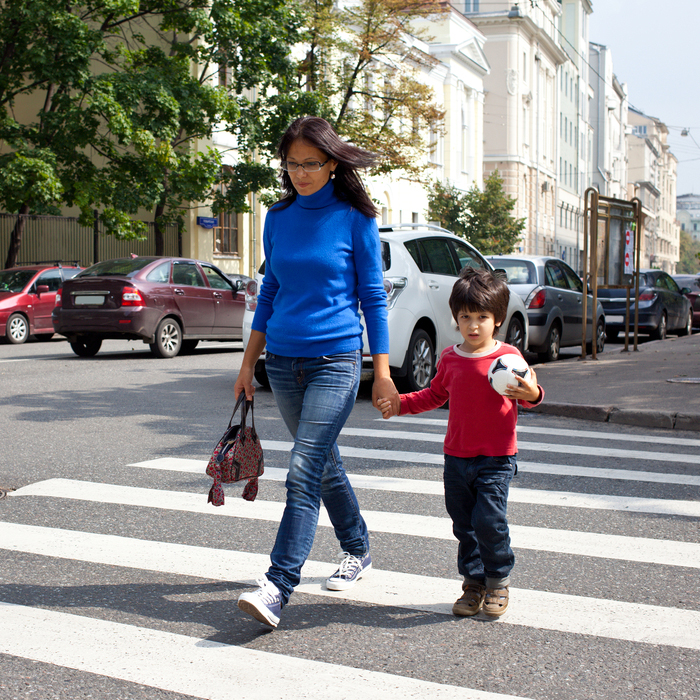 Mother and Child walking down street